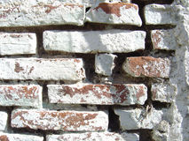 Old brick wall painted white. Closeup of old brick wall painted white Royalty Free Stock Photos