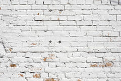 Old brick wall painted with white paint Stock Photo