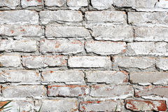 Old brick wall painted with white paint Stock Photography