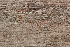 Old brick wall with the pattern for the archs Royalty Free Stock Image