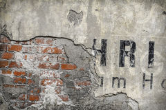 Old brick wall pattern closeup with fragments of letters Stock Photography