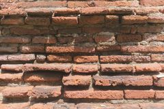 Old brick wall pattern, cracked red brick wall stock images