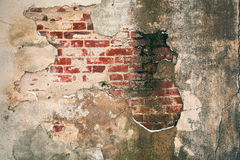 Old brick wall with peeling plaster. Grunge background Royalty Free Stock Photos