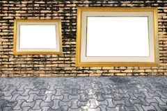 Old brick wall and photo frame. Royalty Free Stock Photo