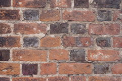 Old brick wall. Photo shows a fragment of the old wall made ​​of bricks Stock Images