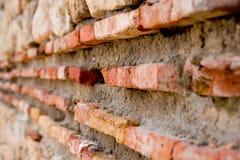 Old brick wall of red bricks. Ancient fortress wall. Medieval Roman citadel fortress. Old red bricks and mortar, grunge royalty free stock photo