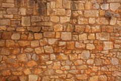 Old brick wall of rough stone Royalty Free Stock Photography