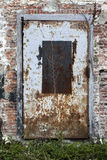 Old brick wall and a  rusty metal door Royalty Free Stock Photo