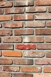 Old brick wall with several colors of brick showcasing craftsmanship of work royalty free stock photos