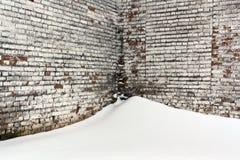 Old brick wall and snow. Royalty Free Stock Photo