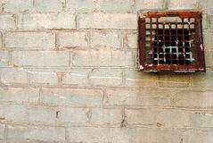 Old brick wall with soft colors. Brick wall with soft color and old iron ventilation Royalty Free Stock Photography