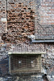 Old brick wall and spikes against bird droppings Stock Images