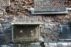 Old brick wall and spikes against bird droppings Royalty Free Stock Photos