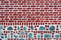 Old brick wall with stones Stock Photo