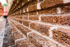 Old brick wall of temple for background Stock Photo