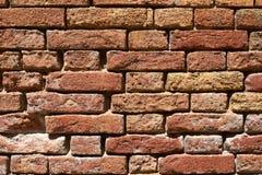 Old brick wall texture background closeup, sunlight stock photos