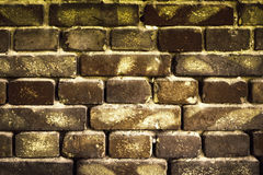 Old brick wall for texture or background, dark brown toned Royalty Free Stock Photo
