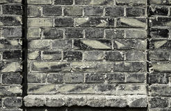 Old brick wall for texture or background, dark color, architectural elements as a brick filled frame Stock Images
