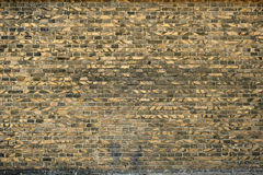 Old brick wall for texture or background, yellow and black color Stock Photos