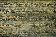 Old brick wall for texture or background, yellow and black color Royalty Free Stock Image