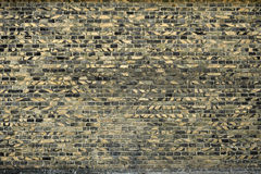 Old brick wall for texture or background, yellow and black color Royalty Free Stock Photo