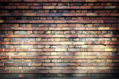 Old brick wall texture with beams of light Royalty Free Stock Photography