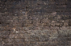 Old brick wall: Texture of dark vintage brickwork Stock Photography