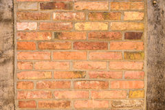 Old brick wall texture with wooden uprights Royalty Free Stock Photography