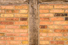 Old brick wall texture with wooden uprights Stock Photography