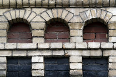 Old brick wall with three niches Royalty Free Stock Images