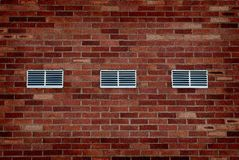 Old Brick Wall with Vents Royalty Free Stock Photo