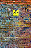 Danger sign on wall Royalty Free Stock Image