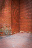 Old brick wall weathered texture and dirty floor Stock Photos