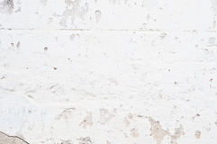 Old brick wall. White old brick wall with breakaway plaster Stock Photo
