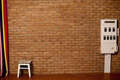 The old brick wall and white Chair Royalty Free Stock Photography