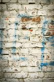 Old brick wall with white paint background texture close up Stock Photos