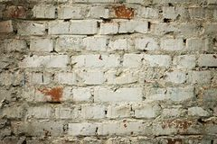 Old brick wall with white paint background texture close up Stock Photo