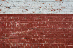 Old brick wall with white paint on top Stock Image