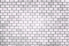 Old brick wall, the white surface of the stone blocks Stock Photos