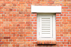 Old Brick Wall with White Window Stock Image