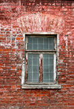 Old brick wall with window background. Window and brick wall of old house Stock Image