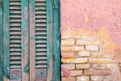 Old brick a wall and window with shutter Royalty Free Stock Photography