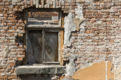 Old brick wall with windows Stock Images