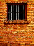 Old Brick Wall With Barred Windows
