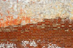Old Brick Wall With Peeling Plaster Grunge Background, Copy Space Royalty Free Stock Photography
