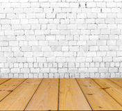 Old brick wall on wood floor Stock Photos
