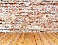 Old brick wall on wood floor Stock Image