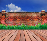 Old brick wall and wood terrace garden. On cloudy day Stock Images