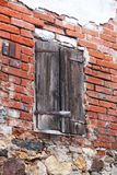 Old brick wall with wooden door in Český Krumlov  in Czech Republic stock photography