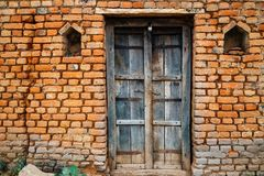 Old brick wall and wooden door in India